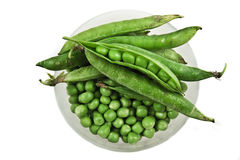 Green peas in a bowl. Close studio shot of mixed green peas in a  white bowl Royalty Free Stock Image