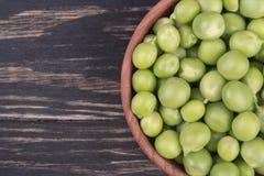 Green peas in a bowl Stock Photos