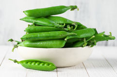 Green peas in bowl Royalty Free Stock Image