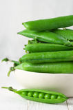 Green peas in bowl Royalty Free Stock Photo