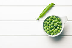 Green peas in bowl Stock Images