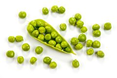 Green peas bright juicy and delicious shot close-up on a white background.  Royalty Free Stock Photo