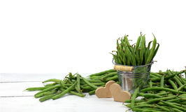 Green peas in a bucket and heart. Concept. Isolated. Agriculture Stock Photo