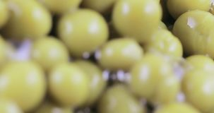 Green peas in bulk. Hill of green peas canned bulk stock video footage