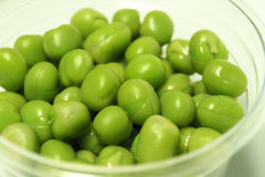 Green peas in clear plastic cup Royalty Free Stock Photo
