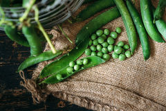 Green peas close up. Viewon sack Stock Photo