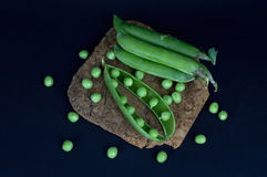 Green peas on the cork substrate Royalty Free Stock Photography