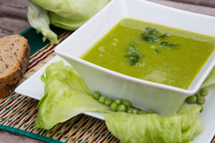 Green peas cream soup with salad leaves Stock Photography