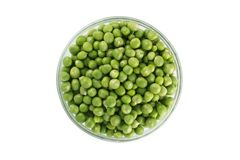 Green peas in a glass bowl. top view Stock Photography