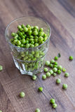 Green peas in a glass. Raw food, vegetables, bean, vegan food Stock Images