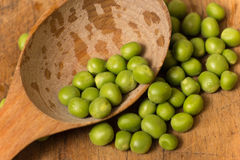 Green peas. Isolated on old wooden background Stock Photography