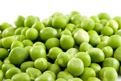 Green peas isolated on the white background. Pile of green peas isolated on the white background. Focused on the lower part of image Stock Photos