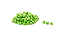 Green peas isolated on a whiteground. Stock Photos