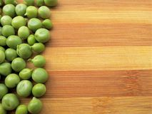 Green peas  line on wooden background Stock Photo