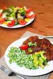 Green peas and meat on a plate Royalty Free Stock Photo