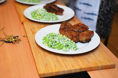 Green peas and meat on a plate Stock Image