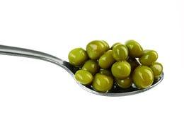 Green Peas On A Spoon Royalty Free Stock Photos