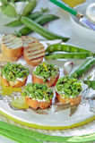 Green peas Open Faced Sandwich. Green peas toast with ricotta and lemon zest, Selective focus Royalty Free Stock Photos