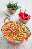 Green peas and paneer. Cheese in a spicy tomato sauce, selective focus Stock Photo