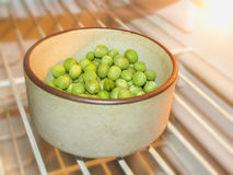 Green Peas and pea fruit the legume on white. Green Peas and pea fruit the legume on white background.Its  a winter food,edible raw,rich in vitamines,good foor Stock Image