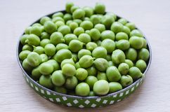Green peas. The pea is most commonly the small spherical seed, Each pod contains several peas Stock Images