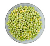 Green peas on a plate Royalty Free Stock Image
