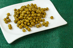 Green peas on a plate Stock Image