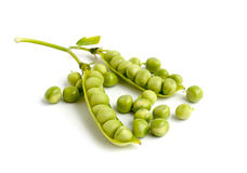 Green peas pods. On a white background Royalty Free Stock Images