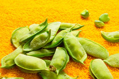 Green peas with pods. Fresh green peas with pods on a textile background Stock Images