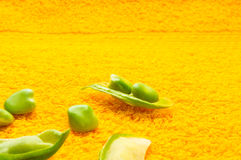 Green peas with pods. Fresh green peas with pods on a textile background Stock Photography