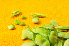 Green peas with pods. Fresh green peas with pods on a textile background Stock Photos