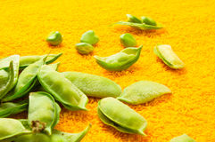 Green peas with pods. Fresh green peas with pods on a textile background Royalty Free Stock Photography