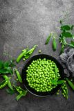 Green peas with pods and leaves Royalty Free Stock Photo