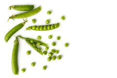 Green peas in pods and scattered on a white. The view from the top. Green peas in pods and scattered on a white background. The view from the top Stock Photo