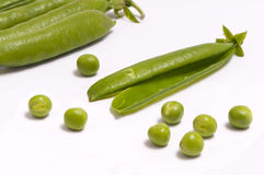 Green peas and pods Stock Images