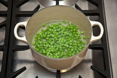 Green peas in pot Stock Image