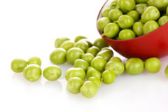 Green peas in a red bowl, Stock Image