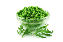 Green peas and rosemary. Green peas in a glass cup and rosemary Royalty Free Stock Image