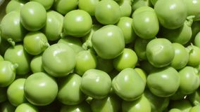 Green peas rotate, top view. stock footage