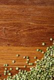 Green peas on rustic wooden background, close-up, top view, selective focus. Some copy space for your inscription. Studio shot. Macro. Nutritious organic Stock Photos