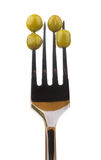 Green peas skewered on fork Stock Photography