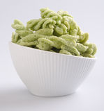 Green peas snack, junk food in white bawl Stock Images