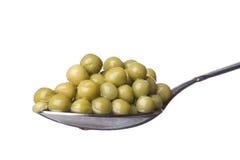 Green peas on spoon macro Stock Photo