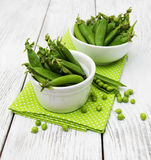Green peas on a table Royalty Free Stock Photography