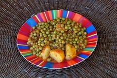 Green peas with tomato sauce Stock Photo