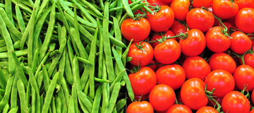 Green peas and tomatoes Stock Photos
