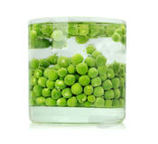 Green peas in the water on the the white background Royalty Free Stock Image