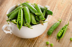 Green peas in  white bowl Stock Images