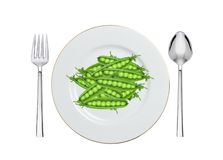 Green peas on white plate isolated on white Royalty Free Stock Image