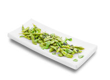 Green peas on white plate under angle Stock Photo